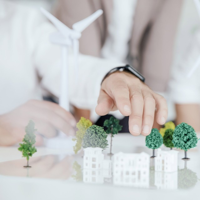 Small model trees and houses on a table